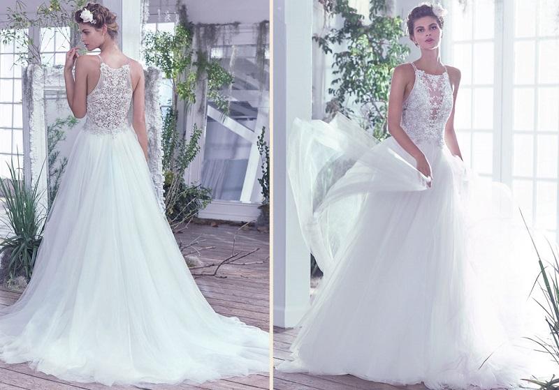 06687ca26e Eis uma opção para noivas clássicas e elegantes. Um vestido de noiva estilo  princesa com decote envolvente
